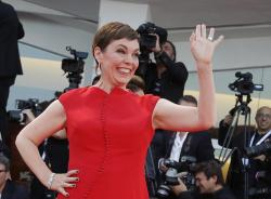 In this file photo dated Saturday, Sept. 8, 2018, Academy Award-winning actress Olivia Colman poses for photographers at the 75th Venice Film Festival in Venice, Italy
