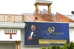 Mexico-based megachurch La Luz del Mundo, leader and self-proclaimed apostle Naasón Joaquín García's 50 birthday celebration portrait, is displayed on the side of the East Los Angeles temple on Friday, June 7, 2019