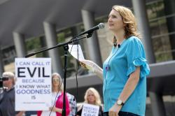 In this Tuesday, June 12, 2018 file photo, rape survivor and abuse victim advocate Mary DeMuth speaks during a rally protesting the Southern Baptist Convention's treatment of women outside the convention's annual meeting at the Kay Bailey Hutchison Convention Center in Dallas