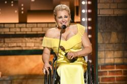 "Ali Stroker accepts the award for best performance by an actress in a featured role in a musical for ""Rodgers & Hammerstein's Oklahoma!""at the 73rd annual Tony Awards at Radio City Music Hall."