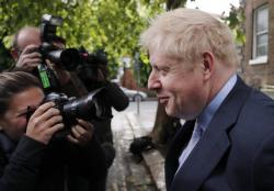 British Conservative Party lawmaker Boris Johnson leaves his home in London, Tuesday, June 11, 2019