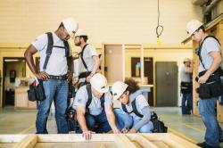 This photo provided by The Home Depot shows students training at the The Home Depot Foundation and HBI's Ft. Stewart Program on a job site in Ft. Stewart, Ga.