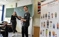Senior students and media scouts Leon Zielinski, right, and Chantal Hueben teach young pupils during a lesson in social media and internet at a comprehensive school in Essen, Germany, Monday, March 18, 2019