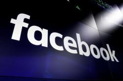 In this March 29, 2018, file photo, the logo for social media giant Facebook, appears on screens at the Nasdaq MarketSite