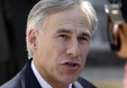 In this July 25, 2011 file photo, Texas Attorney General Greg Abbott talks with the media as he leaves the Tom Green County Courthouse, in San Angelo, Texas