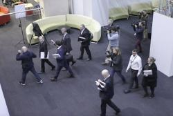 In this June 5, 2019, file image made from video, Australia's Federal Police, top, enter the Australian Broadcasting Corporation, the national public broadcaster, during a raid on their offices in Sydney, Australia