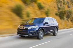 This undated photo provided by Honda shows the 2019 Honda Pilot, a well-rounded three-row family SUV that combines a pleasant ride with a flexible interior package that excels at hauling people and cargo