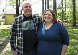 In this May 15, 2019, photo, Jonathan and Beth Dow stand in their backyard in Bennington, Vt.