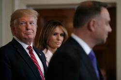President Donald Trump and first lady Melania Trump attend a Polish-American reception with Polish President Andrzej Duda in the East Room of the White House.