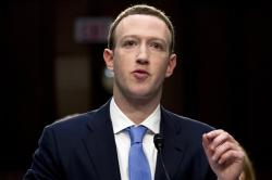 In this April 10, 2018, file photo, Facebook CEO Mark Zuckerberg testifies before a joint hearing of the Commerce and Judiciary Committees on Capitol Hill in Washington