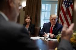 """Iowa Gov. Kim Reynolds and President Donald Trump listen as Pennsylvania Gov. Tom Wolf speaks during a meeting with governors on """"workforce freedom and mobility"""" in the Cabinet Room of the White House."""
