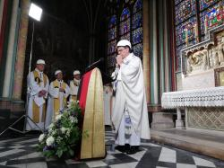 The Archbishop of Paris Michel Aupetit leads the first mass in a side chapel, two months after a devastating fire engulfed the Notre-Dame de Paris cathedral, Saturday June 15, 2019, in Paris.