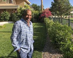 This Monday, June 3, 2019 photo provided by Didier J. Fabien shows O.J. Simpson in the garden of his Las Vegas area home