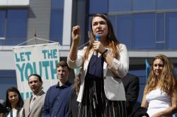 In this June 4, 2019, file photo, Kelsey Rose Juliana, of Eugene, Ore, speaks at a rally for a group of young people who filed an environmental lawsuit against the U.S. government in Portland, Ore.