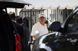 President Donald Trump gets out of his car and heads into the White House in Washington, Sunday, June 16, 2019, after spending the day golfing with Sen. Lindsey Graham, R-S.C., at his golf club in Sterling, Va.