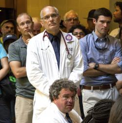 Jenny Warburg, Dr. Charles van der Horst, standing at center, joins a Moral Monday protest at the state legislative building in Raleigh, N.C.