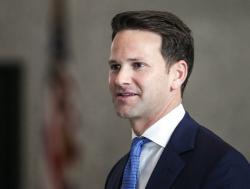 former U.S. Rep. Aaron Schock walks out of the Dirksen Federal Building in Chicago