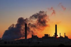 In this July 27, 2018, file photo, the Dave Johnson coal-fired power plant is silhouetted against the morning sun in Glenrock, Wyo.