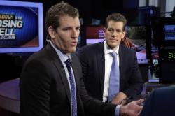 In this Thursday, Oct. 8, 2015 file photo, Tyler Winklevoss, left, and Cameron Winklevoss, founders of Gemini Trust Co., appear on the Fox Business Network, in New York