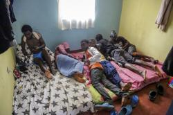 LGBT refugees from Burundi, Rwanda and Congo lie on a mattress in one of the rooms they share in the house where they take shelter in a low-income neighborhood of the capital Nairobi, Kenya.