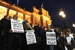 Pro life demonstrators are seen outside the Victorian State Parliament, Melbourne.