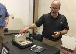 In this Nov. 16, 2018, file photo, Stephen Meer, chief information officer from ANDE, demonstrates in Chico, Calif., his company's Rapid DNA analysis system