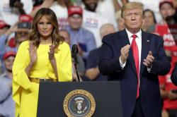 First lady Melania Trump and President Donald Trump greet supporters at a rally to formally announce his 2020 re-election bid Tuesday, June 18, 2019, in Orlando, Fla.