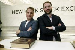Slack Technolegies co-founders Stewart Butterfield, left, and Cal Henderson pose for photos on the New York Stock Exchange trading floor before their company's IPO, Thursday, June 20, 2019
