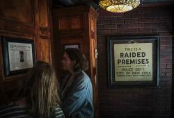 Stonewall Inn visitors read news clipping about the 1969 riots that followed a police raid of a gay bar at the site, in New York.