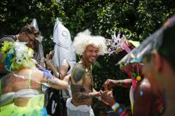 Parade attendees in costume make their way along Surf Avenue during the 37th annual Mermaid Parade at Coney Island.
