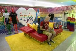 A customer takes a break from shopping at the Pride and Joy shop in the Macy's flagship store in New York.