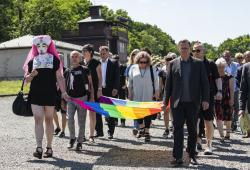 People carry a rainbow flag in remembrance for prisoners assigned a pink triangle in the former Nazi concentration camp Buchenwald within the Christopher Street Day in Weimar.