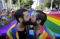 Revelers kiss during the annual gay pride parade along Paulista avenue in Sao Paulo, Brazil.
