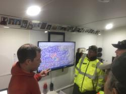 This April 17, 2017, photo provided by Michael St. John shows search and rescue volunteer and SARTopo creator Matt Jacobs, left, and search and rescue volunteers Mike Russo, center, and Bob Gehlen, right, in Sierraville, California, as they consult a SARTopo map while making plans to search for a missing aircraft