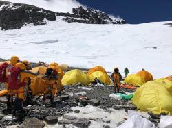 This May 21, 2019, photo provided by climber Dawa Steven Sherpa shows Camp Four, the highest camp on Mount Everest littered with abandoned tents