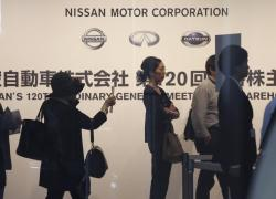 Shareholders arrive for Nissan's general meeting of shareholders in Yokohama, near Tokyo, Tuesday, June 25, 2019