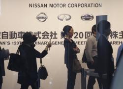 Shareholders arrive for Nissan's general meeting of shareholders in Yokohama, near Tokyo, Tuesday, June 25, 2019