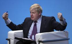 Britain's prime ministerial contender Boris Johnson addresses Conservative Party members during the Conservative Party leadership contest at the ICC in Birmingham, England, Saturday June 22, 2019