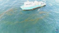 This September 2018 photo provided by NOAA shows a NOAA research vessel at a Taylor Energy production site in the Gulf of Mexico
