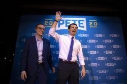 Democratic presidential candidate Pete Buttigieg, right, and husband, Chasten Glezman, acknowledge supporters after speaking at a campaign event in West Hollywood, Calif.