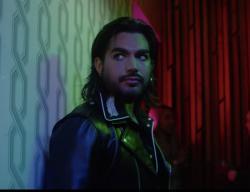 """Adam Lambert in his music video for """"Comin in Hot."""""""
