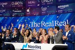 Julie Wainwright, center, CEO of The RealReal, celebrates her company's IPO at the Nasdaq opening bell.
