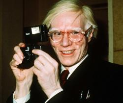 Andy Warhol smiles in New York in 1976.