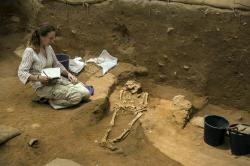 This Tuesday, June 28, 2016 file photo shows an archeologist taking notes at an ancient Phillstine cemetery near Ashkelon, Israel.