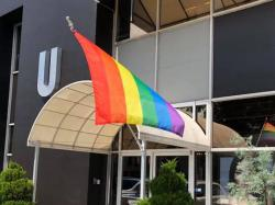 The Pride flag at Salon U in Homewood, Alabama flies fearlessly in the face of intimidation and hate