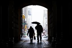 Pedestrians pass beneath City Hall in Philadelphia.
