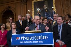Senate Minority Leader Chuck Schumer, D-N.Y. , center, with House Speaker Nancy Pelosi, D-Calif., left.