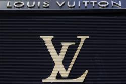 The logo of Louis Vuitton, a fashion house and luxury retail company is pictured on their store on the Champs Elysees Avenue in Paris, France.