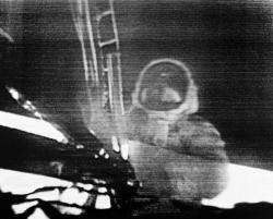 In this July 20, 1969 image made from television, Apollo 11 astronaut Neil Armstrong steps onto the surface of the moon.
