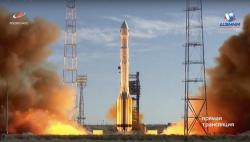 In this frame grab taken from video on Saturday, July 13, 2019, and distributed by Roscosmos Space Agency Press Service, a Russian Proton-M rocket takes off from the launch pad at Russia's space facility in Baikonur, Kazakhstan